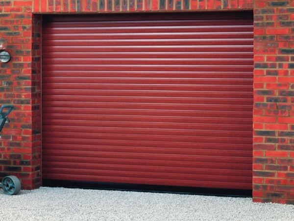 Red garage roller shutters fitted by our team