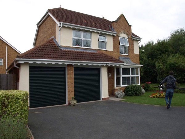 Double garage roller shutters installed at home