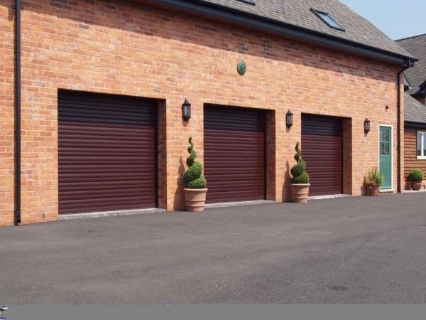 Triple garage roller shutters install