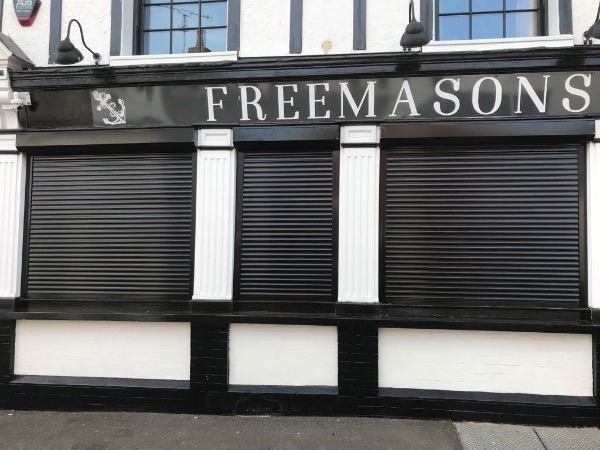 Traditional shop front shutters installed